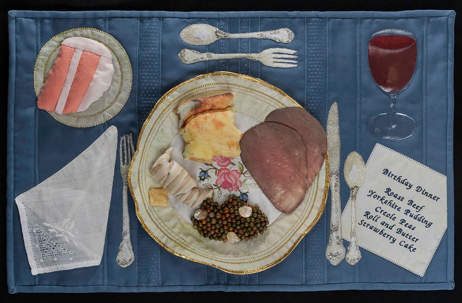 Art quilt of food on a table by Susanne Miller Jones